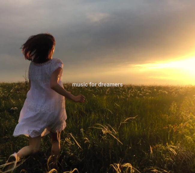Woman running in a field. Music for dreamers.